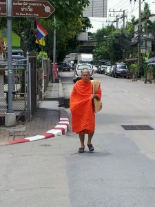 Monk walking on street in Bangkok, Thailand
